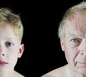 Old man and boy comparison. Grandfather and grandson comparison on black isolated background royalty free stock photos
