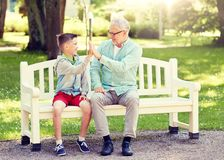 Old man and boy making high five at summer park stock image