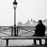 Old man  in the bridge of arts in paris Royalty Free Stock Images