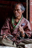 Old man on bridge in Timphu begging for money Stock Image