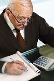 Old man calculate his expenses Royalty Free Stock Image