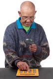 Old man with calculator Royalty Free Stock Photos