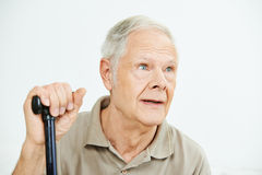 Old man with can looking pensive Royalty Free Stock Photo
