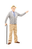 Old man with cane gesturing with hand Stock Image