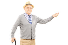 Old man with cane gesturing with hand Stock Photos