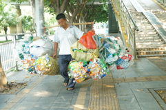 The old man carrying a load of waste plastic bottles Royalty Free Stock Images