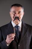Old man with carton moustaches Stock Photos