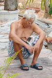 Old man with cat. Asian old man sitting with cat Stock Photography