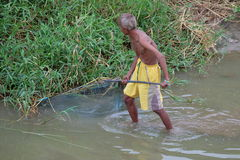 Old man catch some fish, old man find some fish with thailand traditional tool Stock Images