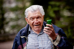 Old Man with Cell Phone Royalty Free Stock Photography