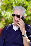 Old man with cellphone Royalty Free Stock Image