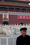 Old man and Chairman Mao portrait Stock Photos