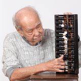 Old man and chinese abacus Royalty Free Stock Photos