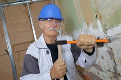 Old man with chisel and hammer. Old man with a chisel and hammer royalty free stock image