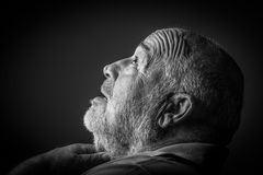 Old man choking Stock Image