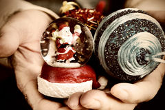 Old man with christmas ornaments. Closeup of an old caucasian man with some christmas ornaments in his hands stock photography