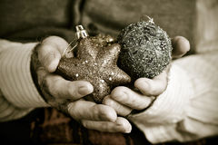 Old man with christmas ornaments, in sepia toning Royalty Free Stock Images
