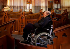 Old man in church Royalty Free Stock Photos