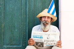Old man with cigar and newspaper in Havana Royalty Free Stock Photography