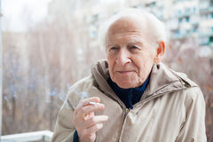 Old man with a cigarette Royalty Free Stock Image