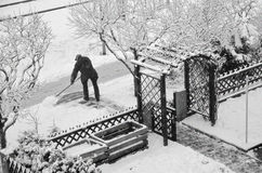 Old man cleaning snow Royalty Free Stock Photos