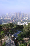 Old man are climbing the hill in the morning in Dalian of China . Royalty Free Stock Photography