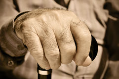 Old man. Closeup of the hand of an old man with a walking stick Royalty Free Stock Photography
