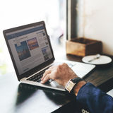 Old Man Coffee Shop Reading News Concept. Senior man's hand surfing internet Royalty Free Stock Photos