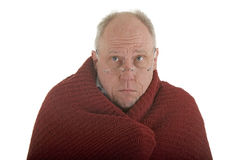 Old Man Cold in Blanket Stock Photography