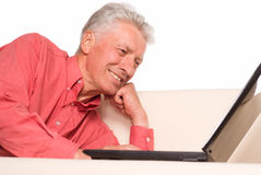 Old man with computer Royalty Free Stock Image