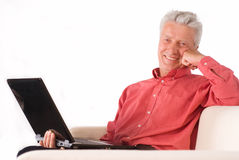 Old man with computer Stock Image