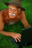 Old man with computer Royalty Free Stock Images