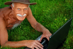Old man with computer Stock Photos