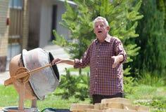 Old man with concrete mixer Stock Photo