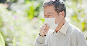 Old man cough outdoor. Old man wear mask and cough outdoor royalty free stock photo