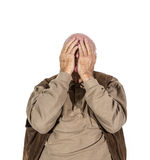 Old man covers his face with his hands Royalty Free Stock Images