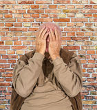 Old man covers his face with his hands Royalty Free Stock Photos