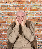 Old man covers his face with his hands Royalty Free Stock Photo
