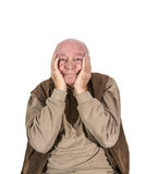 Old man covers his face with his hands Stock Image