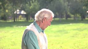 Old man with crossed arms. stock video