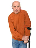 Old man with crutch Stock Image