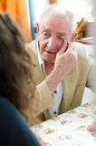 Old man crying. At home stock photos
