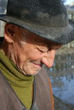 Old man crying. Sad old man with hat on his head royalty free stock image