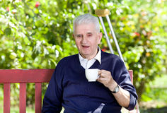 Old man with cup of coffee Stock Photo
