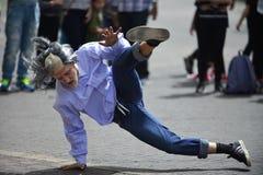 Old man dancing break-dance Stock Images