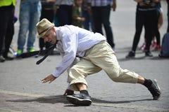 Old man dancing break-dance Royalty Free Stock Photo