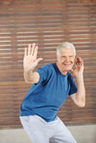 Old man dancing in fitness center Royalty Free Stock Photos