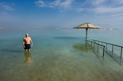Old man in dead sea. Royalty Free Stock Images