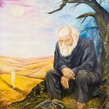 The old man by the desolate fire. Allegory of resentment. Stock Photo