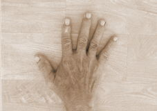 Old man dirty hand. Sepia old male dirty hand on wood background Royalty Free Stock Image